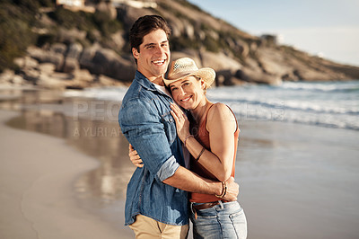 Buy stock photo Shot of a middle aged couple spending the day at the beach