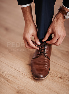 Buy stock photo Cropped shot of an unrecognizable man putting on his shoes