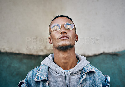 Buy stock photo Shot of a young man in the city