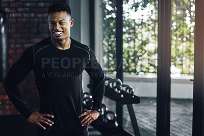 Buy stock photo Shot of a confident young man working out at a gym