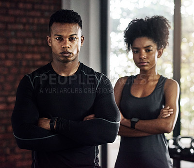 Buy stock photo Portrait of a confident young man and woman working out at a gym