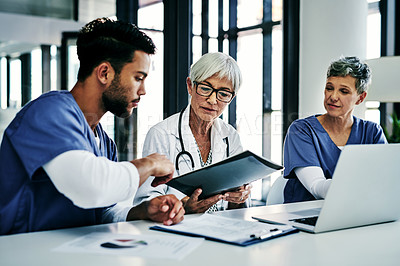 Buy stock photo Shot of a team of medical professionals having a meeting together inside a hospital boardroom