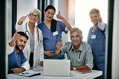 Buy stock photo Portrait of a team of medical professionals posing with their thumbs up during a meeting together inside a hospital boardroom