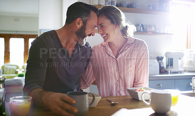 Buy stock photo Cropped shot of a middle aged couple having coffee in the morning
