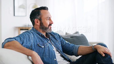 Buy stock photo Cropped shot of a middle aged man relaxing at home