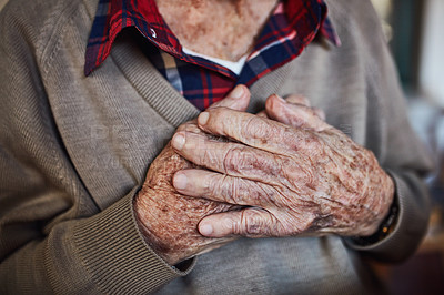Buy stock photo Cropped shot of an unrecognizable senior man holding his chest in pain