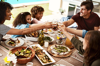 Buy stock photo Shot of a group of people sharing a meal