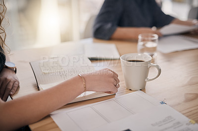 Buy stock photo Closeup shot of a businessperson writing notes during a meeting in an office