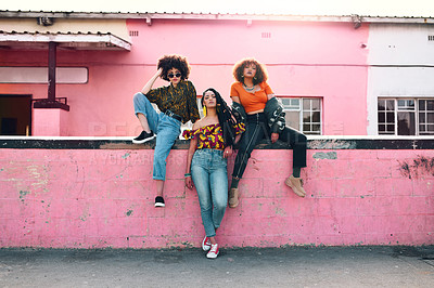 Buy stock photo Full length shot of three attractive and stylish young women posing together against an urban background