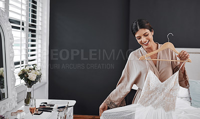 Buy stock photo Cropped shot of an attractive young bride getting ready for her wedding ceremony in her bedroom