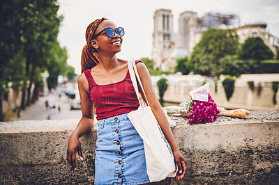 Buy stock photo Shot of a young woman touring the city of Paris