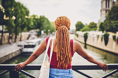 Buy stock photo Rearview shot of a young woman touring the city of Paris