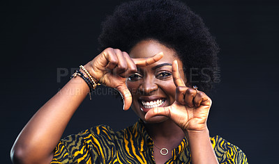 Buy stock photo Cropped shot of a happy young woman posing against a dark background