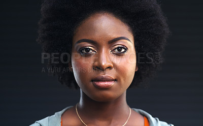 Buy stock photo Cropped shot of a young woman posing against a dark background