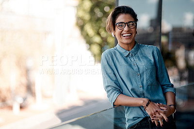 Buy stock photo Cropped portrait of an attractive young woman wearing earpods and standing on a balcony alone