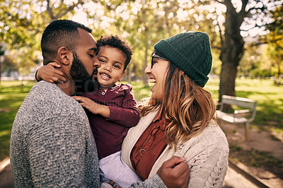 Buy stock photo Shot of a couple bonding with their little son at the park