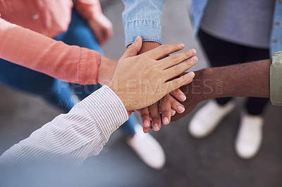 Buy stock photo Cropped shot of a group of businesspeople joining hands in solidarity in a modern office