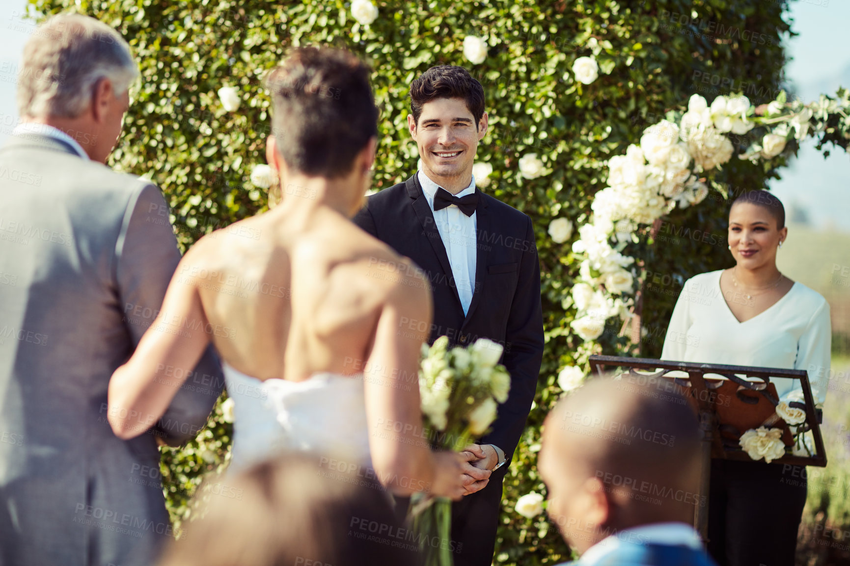 Buy stock photo Shot of a mature man walking his daughter down the aisle while her groom waits at the wedding altar
