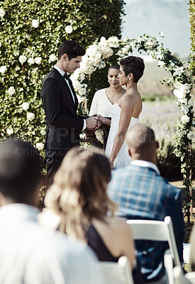 Buy stock photo Shot of a young couple getting married in a garden