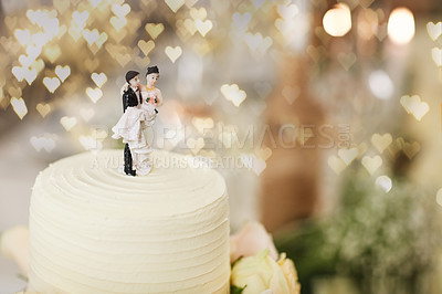 Buy stock photo Shot of a cake topped with plastic bride and groom figurines at a wedding reception