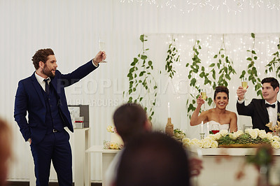 Buy stock photo Shot of a young man giving a toast and speech at a wedding reception