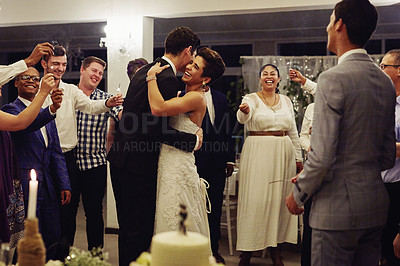 Buy stock photo Shot of a young couple dancing at their wedding reception while surrounded by their friends and sparklers