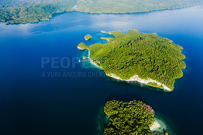 Buy stock photo High angle shot of beautiful green islands in the ocean