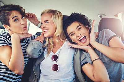 Buy stock photo Shot of girlfriends out on a road trip together