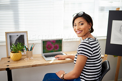 Buy stock photo Portrait of an attractive young artist using a laptop while working inside her studio at home