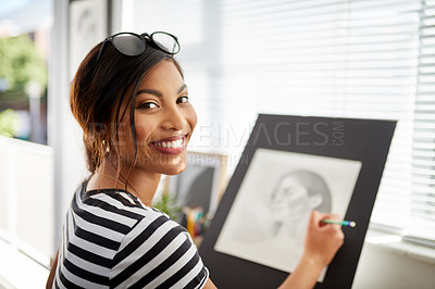 Buy stock photo Portrait of an attractive young artist drawing a portrait of a woman inside her studio
