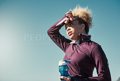 Buy stock photo Cropped shot of an attractive young woman out for a run