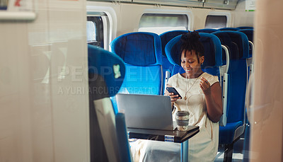 Buy stock photo Cropped shot of an attractive young woman sitting and wearing earphones while listening to music from her cellphone