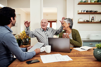 Buy stock photo Cropped shot of a handsome young businessman sitting and bonding with his senior clients during a meeting in their home