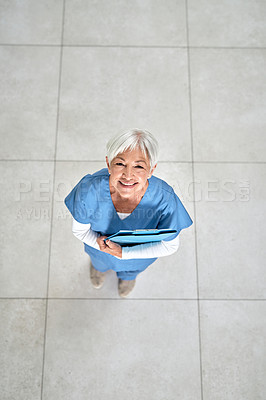 Buy stock photo Portrait of a senior medical practitioner holding a clipboard in a hospital
