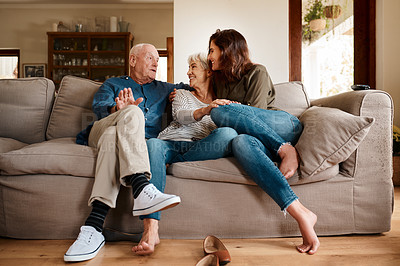 Buy stock photo Full length shot of an affectionate young woman spending time with her elderly parents in their living room at home