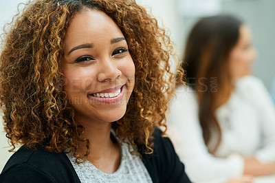 Buy stock photo Portrait of an attractive young designer smiling and feeling cheerful during a meeting with colleagues at work