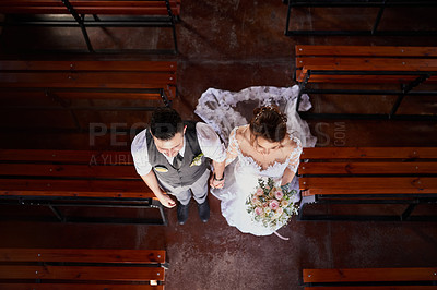 Buy stock photo High angle shot of a young couple walking down the aisle on their wedding day