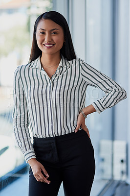Buy stock photo Portrait of an attractive young businesswoman posing with her hand on her hip inside her office