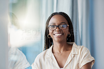 Buy stock photo Portrait of an attractive young businesswoman posing with her arms folded inside her office