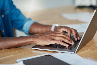 Buy stock photo Shot of an unrecognizable businessman working on a laptop inside his office