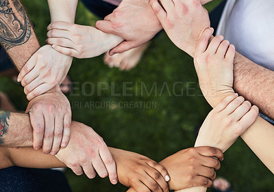 Buy stock photo Cropped shot of an unrecognizable group of people holding on to each others wrists