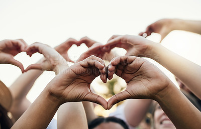Buy stock photo Cropped shot of a group of unrecognizable people forming a hearts with their hands