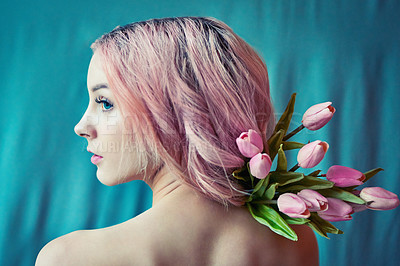 Buy stock photo Cropped shot of a beautiful young woman posing with pink flowers