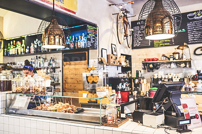 Buy stock photo Shot of a countertop with an arrange of baked goods placed on top of it inside of a coffee shop during the day