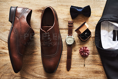 Buy stock photo Still life shot of formal shoes alongside a suit and other accessories on a wooden surface