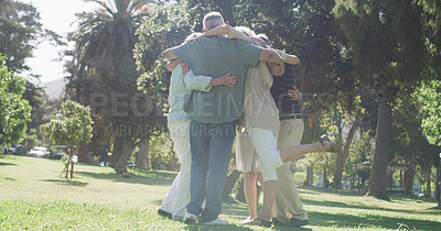 Buy stock photo Full length shot of a group of unrecognizable senior friends embracing each other in a circle in a park