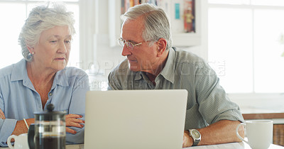 Buy stock photo Shot of senior couple using a laptop together at home
