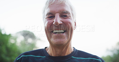 Buy stock photo Cropped portrait of a cheerful senior man smiling while standing in a park during the day