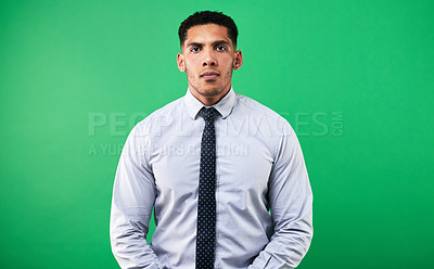 Buy stock photo Cropped portrait of a handsome young male weather forecaster standing against a green background