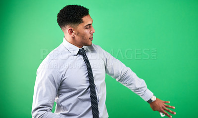 Buy stock photo Cropped shot of a handsome young male weather forecaster reporting the weather against a green background